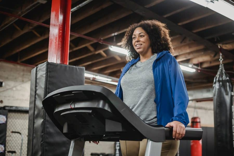 A heavy person works out on a Treadmill