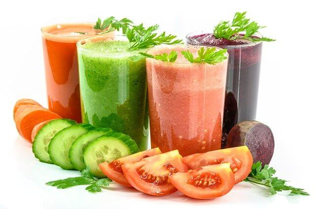 Colorful Juices from different Types of Juicers