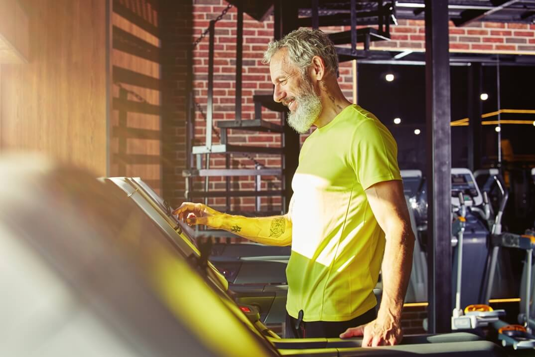 An Older Male Happily Working Out on a Treadmill for Garage