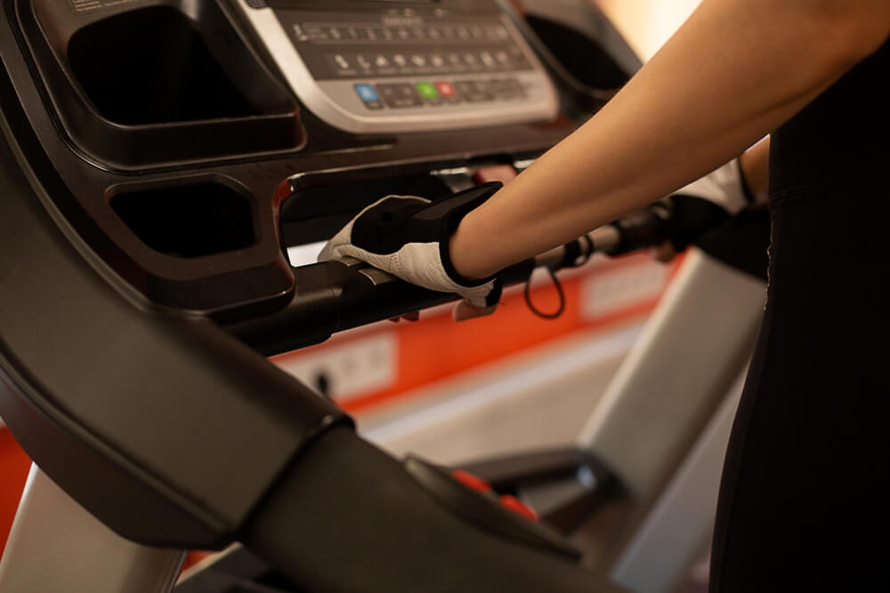 Person Working Out on one of the Best Folding Treadmills to save space