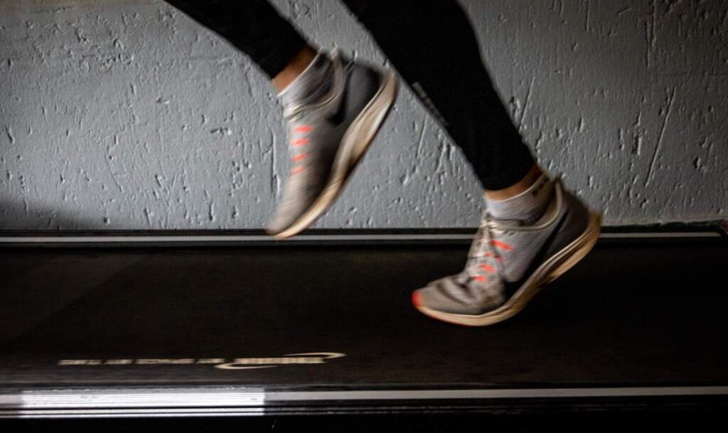 A person running on a quiet treadmill